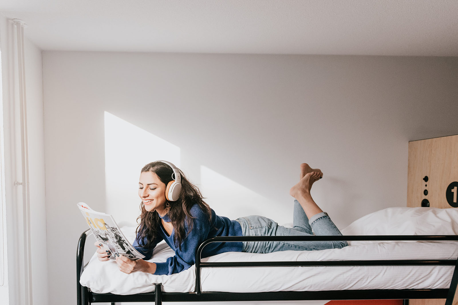 girl reading a magazine in a bunk bed