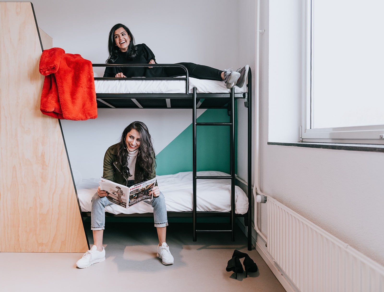 Two girls and bunk beds in Via Amsterdam hostel