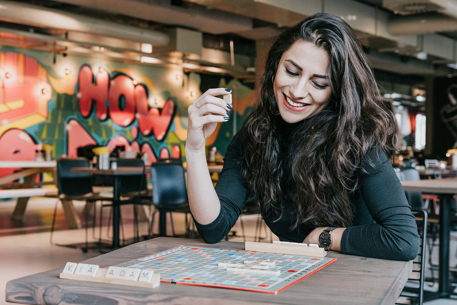 girl playing a game of scrabble